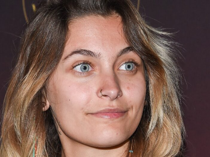 Paris Jackson looks to the side while walking the red carpet