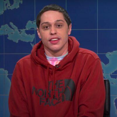 screenshot of Pete Davidson in a red hoodie on SNL's Weekend Update