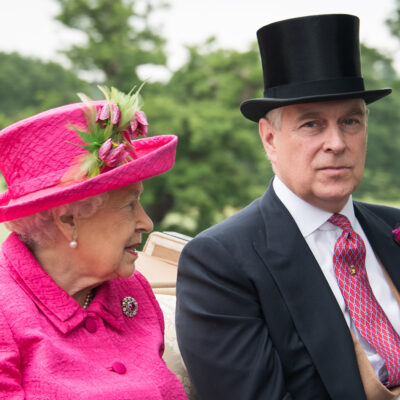 Queen Elizabeth riding in a carriage with Prince Andrew
