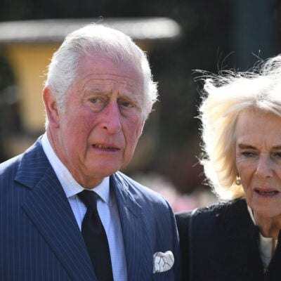 Prince Charles and Camilla Parker Bowles looking distraught.