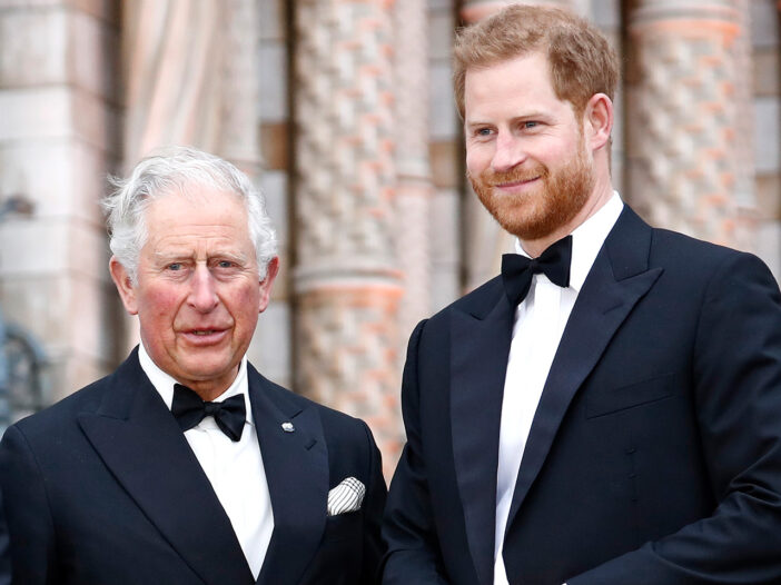 Prince Harry (right) standing with Prince Charles in tuxedos