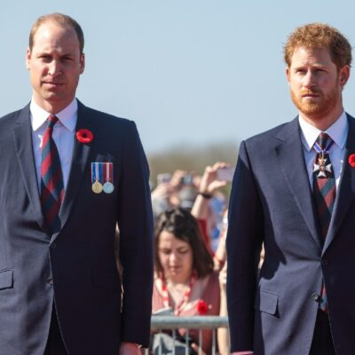 Prince William, left, and Prince Harry, right, stand together at the centenary service to commemorate the battle of Vimy Ridge