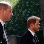 Prince William in the foreground, walking with Prince Harry at Prince Philip's funeral