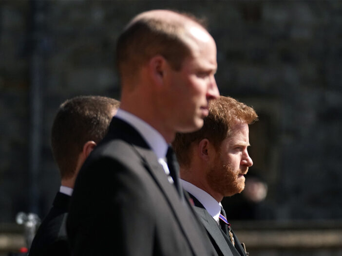 Prince William in the foreground walking with Prince Harry at Prince Philip's funeral.
