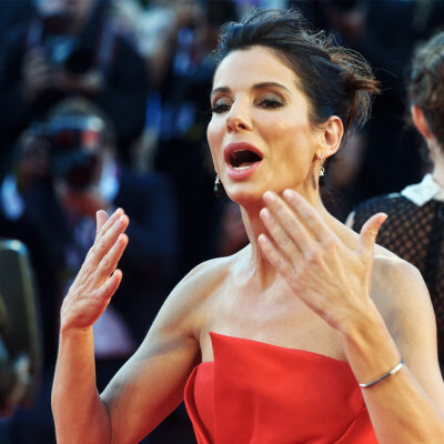 Sandra Bullock making a dramatic motion with her hands.