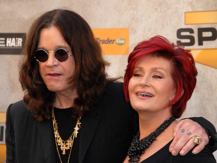 Sharon Osbourne, with her husband Ozzy's arm around her.