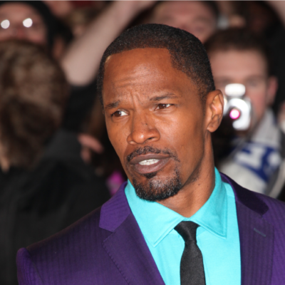 Jamie Foxx wearing a purple and bright blue suit