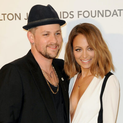 Nicole Richie in a white jacket with Joel Madden in a black outfit
