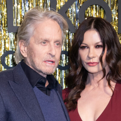 Michael Douglas in a blue suit with Catherine Zeta Jones in a red dress