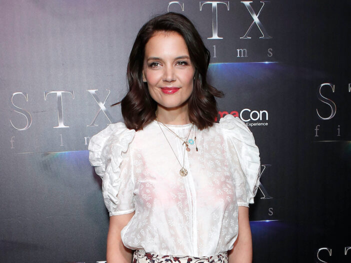 Katie Holmes in a sheer white blouse