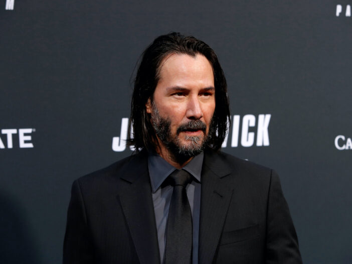 Keanu Reeves in a black suit at the John Wick premiere