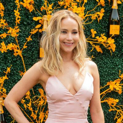 Jennifer Lawrence smiling in a pink dress