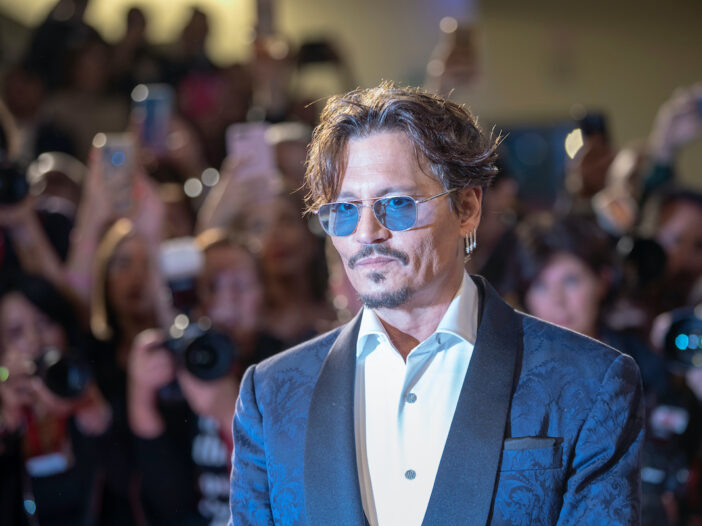 Johnny Depp in a suit on the red carpet