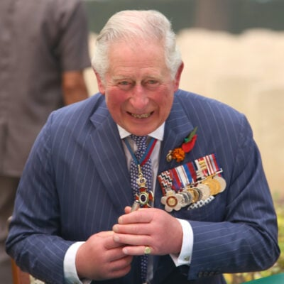 Prince Charles smiling in a suit