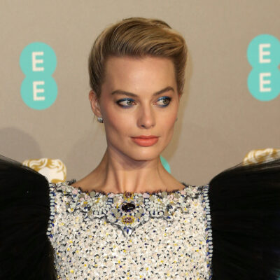 Margot Robbie in a white and black dress