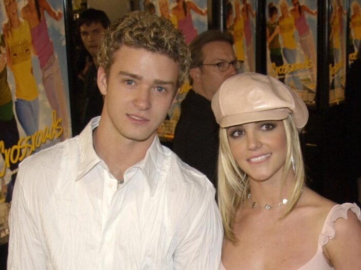 Justin Timberlake and Britney Spears smiling together in 2002