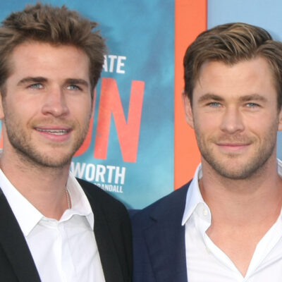 Liam and Chris Hemsworth in suits