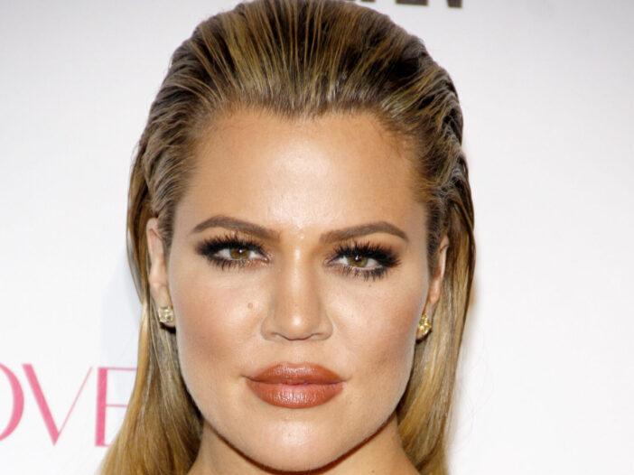 A close up shot of Khloe Kardashian's face.