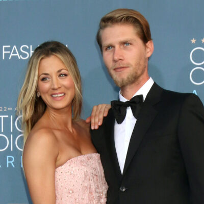 Kaley Cuoco in a pink dress and Karl Cook in a tuxedo