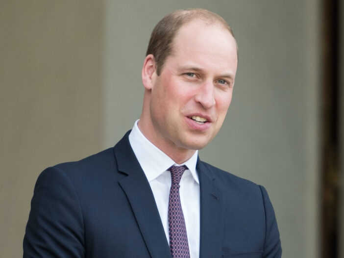 Prince William smiling in a suit