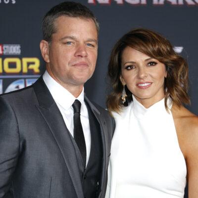 Matt Damon in a suit with wife Luciana Barroso in a white dress