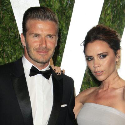 David Beckham in a tuxedo with Victoria Beckham in a white dress