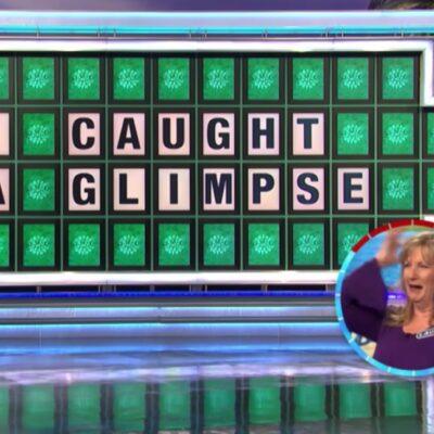 Laura Trammell wins the bonus round puzzle as Vanna White applauds her