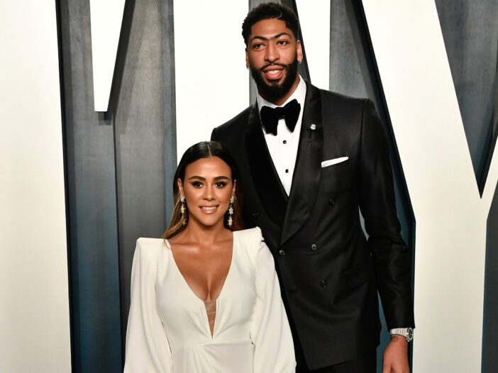 Anthony Davis wearing a black tuxedo with his girlfriend, Marlen P, who is wearing a white dress.
