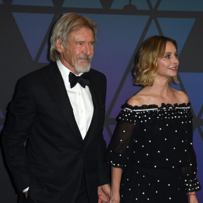 Harrison Ford in a tux with wife Calista Flockhart in a navy dress