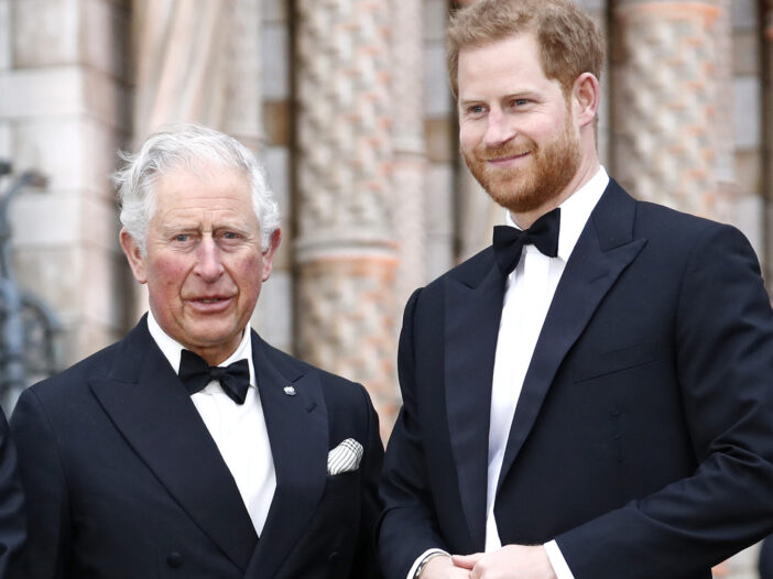 Prince Charles on the left, Prince Harry on the right, both in tuxedos