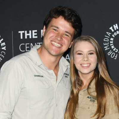 Chandler Powell and Bindi Irwin smiling in khaki