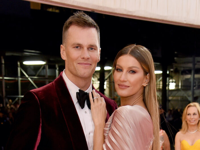 Tom Brady in a tuxedo with Gisele Bundchen in a dress