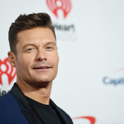 close up of Ryan Seacrest in a navy suit