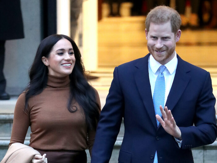 Meghan Markle and Prince Harry walk down stairs together