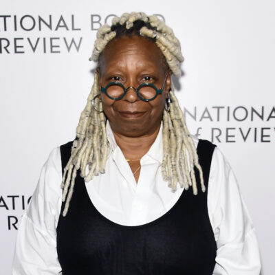 Whoopi Goldberg in a white and black outfit