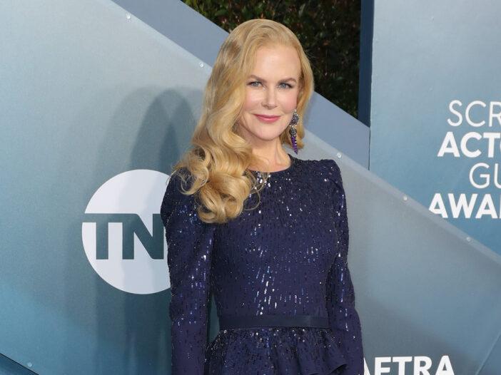 Nicole Kidman smiling in a blue dress