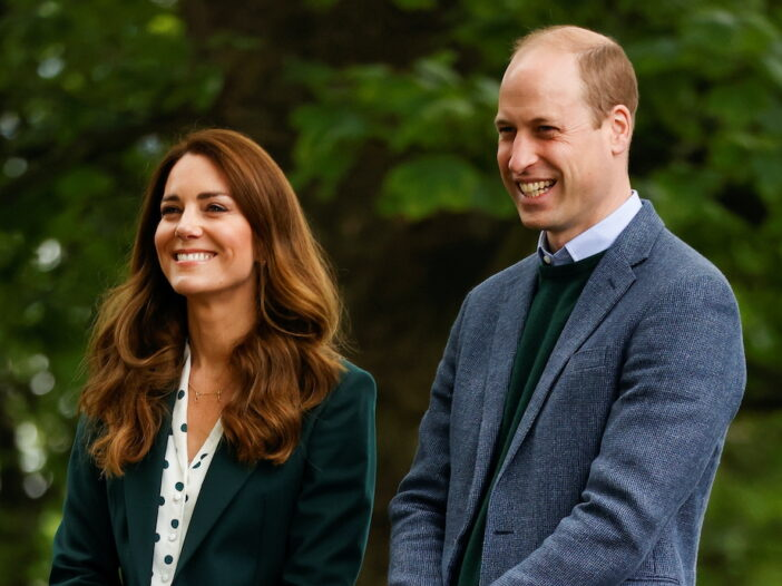 Kate Middleton in a green cardigan with Prince William in a grey jacket