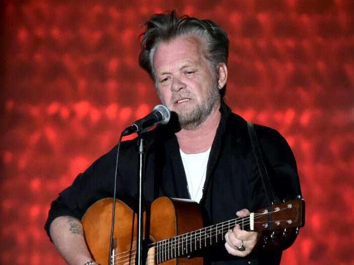 John Mellencamp playing on stage