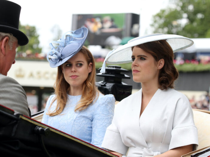 Princess Beatrice and Princess Eugenie ride in a carriage