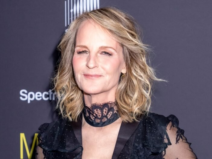 Helen Hunt at a red carpet event wearing a black blouse.