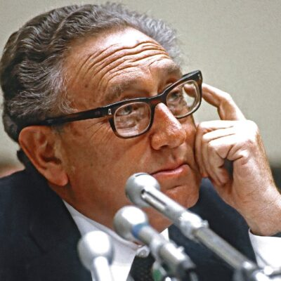Henry Kissinger wearing a suit on Capitol Hill in 1984.