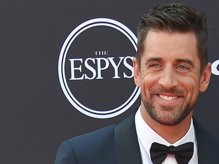 Aaron Rodgers stands on the ESPYS red carpet