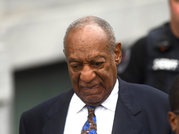 Bill Cosby in a suit, leaving court in 2018