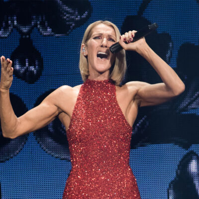 Celine Dion performing in a red dress.