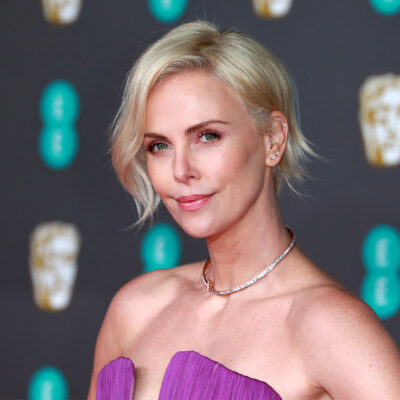 Close up of Charlize Theron in a purple dress.