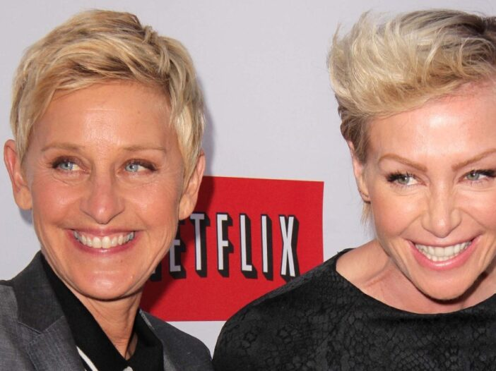Ellen DeGeneres and Portia de Rossi smile for the camera at a premiere