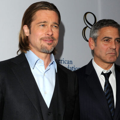 Brad Pitt on the left, George Clooney, looking annoyed, on the right.