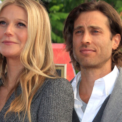 Close up of Gwyneth Paltrow on the left standing with Brad Falchuk on the right.