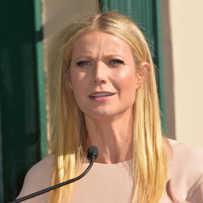 Gwyneth Paltrow wears a beige dress as she speaks at her Hollywood Star Of Fame ceremony