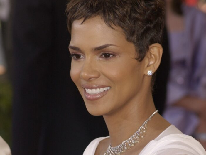 Halle Berry wears a white dress as she walks the red carpet